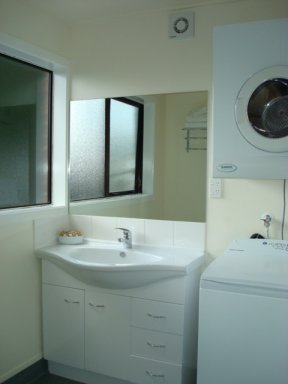 Laundry facilities in one of the bathrooms of a three bedroom apartment